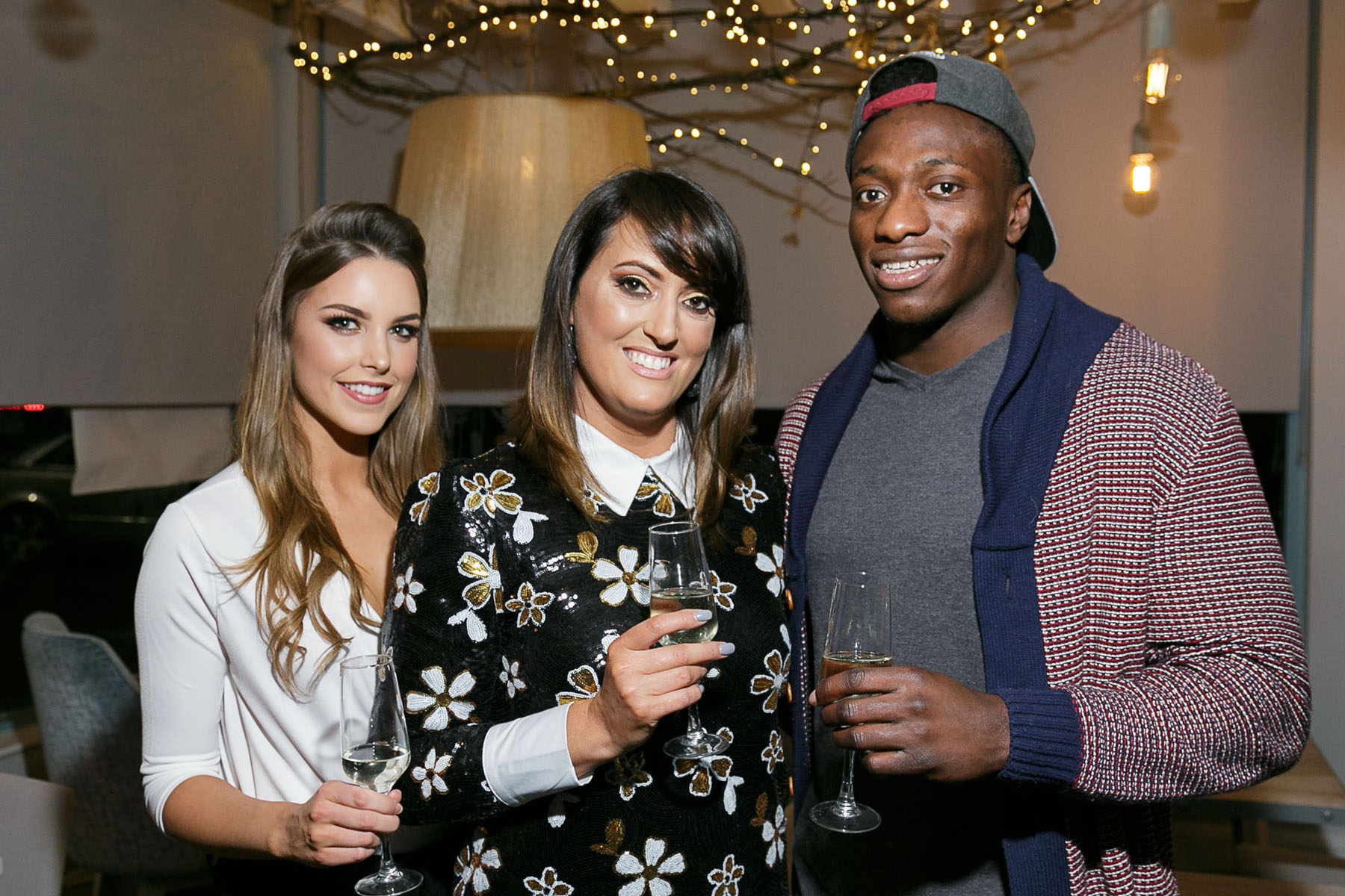 Róisín Nolan (Catwalk Models) Niye  Adeolokun (Connacht Rugby) with Vicky Casey proprieter of Caprice Cafe